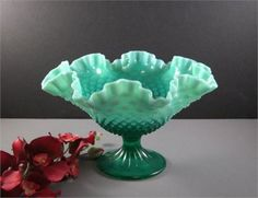 Emerald green opalescent Fenton treasure is featured on page 102 of The Big Book of Fenton Glass 1940 - 1970 and are not easy to find. A direct estate offering is in VERY GOOD pre-owned condition only showing what appears to me to be diamond ring scratches on the inner bowl but I may be wrong..Will make quite the visual statement..Not marked   I believe this bowl in this color was offered from 1959 thru 1961 and again I maybe wrong.   is approx: 10: across at the top opening x 6.5 high…
