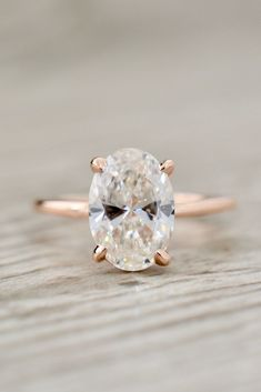 Style 4027 features a 10.35x7.3mm, 2.00ct oval diamond in a four-prong flush-set basket petite 1.6mm solitaire engagement ring.