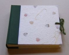Photo Album - Handmade work    Dimension: 20,5 x 19 cm, 30 pages (60 front and back) of heavy ivory card stock with interleaved glassine sheets.   It's possible customize the album by choosing the color of the canvas, the kind of paper and the size.