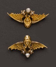 Two  Pearl & Gold Egyptian Revival Pins. 14k yellow gold, circa estimated 1915 - 1920.
