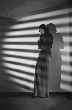 Studio Harcourt. Lucienne Boyer, 1940. >>> What would film noir have ever been without Venetian blinds?