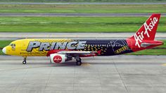 AirAsia (MY) Airbus A320-216 9M-AHL aircraft, painted in ''Prince Lubricants'' special colours Apr. 2014 - Dec. 2016, skating at Vietnam Hanoi Noi Bai International Airport. 02/07/2016.