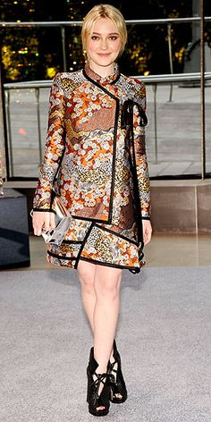 DAKOTA FANNINGThe star may be small, but she loves a big fashion risk: She chooses a kimono-print patchwork minidress and chunky lace-up booties – both by Proenza Schouler – paired with a mirrored silver clutch for the awards.