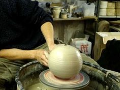 Making a ball form on the wheel.