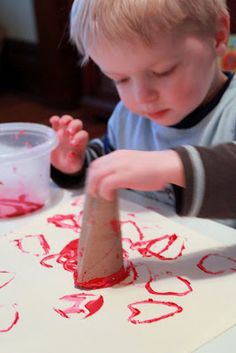 Stamped Heart. A Valentine's Day Art Project using a recycled toilet paper tube! An easy one for toddlers to do!