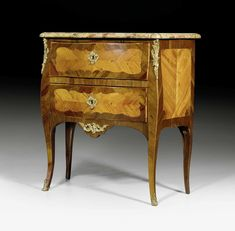 "c1760 SMALL CHEST OF DRAWERS, Louis XV, with illegible signature, guild stamp, Paris ca. 1760. Tulipwood and rosewood in veneer, inlaid with reserves and ornamental frieze. 2 drawers. Gilt bronze mounts and sabots. Shaped ""Brèche d'Alep"" top. Alterations. 80x42x85 cm. Sold for CHF 3 500 (hammer price)"