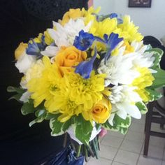 Summer bridal bouquet in canary yellow, white and blue. A Flowers by Miss Mallory design.