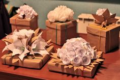 paper flower tutorials - not in English but the pictures give you great ideas!