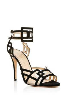 "**Charlotte Olympia**  taking geometric glamour to new, refined heights      designer Charlotte Dellal        ""Between The Lines""    high heeled sandals with black suede"