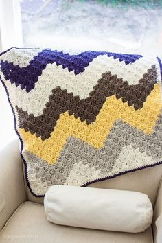 Create a simple geometric design with this c2c chevron baby blanket.