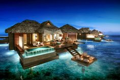 Sandals Royal Caribbean: Overwater Bungalow - Night View. Photo Credit: ©Sandals Resorts International.