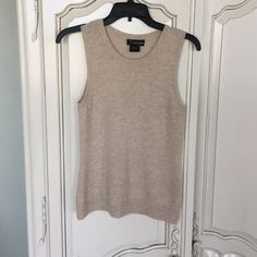 Cashmere sleeveless top Bloomingdales cashmere top. Oatmeal color. Great neutral to go under cardigans or to wear on its own. True to size, not oversized Bloomingdales Tops Tank Tops