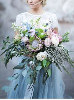 Wedding Inspiration at Zion National Park A blue hued protea bouquet with soft pink pops and lots of greenery.A blue hued protea bouquet with soft pink pops and lots of greenery. Protea Wedding, Floral Wedding, Wedding Colors, Green Wedding, Trendy Wedding, Wedding Greenery, Wedding Trends, Wedding Venues, Wedding Ceremony