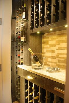 A closet-sized climate controlled wine area -- what a fabulous use of space!    –Various Custom Cabinetry | Vision Woodworks  www.VisionCabinetry.com