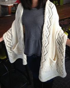 Knitting Pattern for Lace Reader's Wrap - Lace shawl with pockets by Lisa Carnahan in aran yarn. Pictured project for Lace Reader's Wrap by NittanyKnits