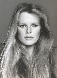 KIM BASSINGER   Statement hair, square bone structure, full lips - she has it all. But it makes me wonder: how much makeup went into producing this no makeup look? Or is it the bnw photography?