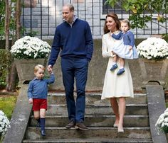 Britain's Prince William (2nd L), Catherine, Duchess of Cambridge, Prince George (L) and Princess Charlotte (R) arrive at a children's party at Government House in Victoria, British Columbia, Canada,