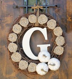 DIY fall wreath--Grapevine wreath with painted pumpkins and monogram from Shanty 2 Chic blog