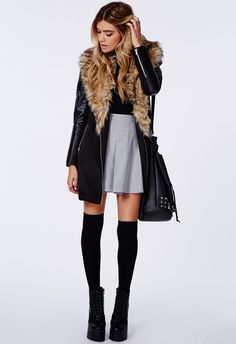 A black leather coat and a grey pleated skirt feel perfectly suited for weekend activities of all kinds. Black chunky leather flat boots will contrast beautifully against the rest of the look.   Shop this look on Lookastic: https://lookastic.com/women/looks/coat-turtleneck-skater-skirt/23564   — Black Leather Coat  — Black Turtleneck  — Grey Skater Skirt  — Black Studded Leather Bucket Bag  — Black Knee High Socks  — Black Chunky Leather Lace-up Flat Boots
