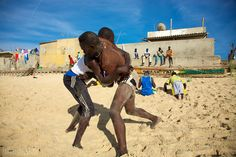 SAINT-LOUIS, SENEGAL, DECEMBER 4: Unidentified group of wrestlers training on the beach. The Senegalese wrestling is a type of Folk wrestling traditionally performed by the Serer people and now a national sport in Senegal. Senegal 2012