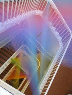 """Thread installations by Gabriel Dawe: """"I think of them as existing in a space between the material and the immaterial; or like some sort of alchemical experiment where I attempt to materialize light."""""""