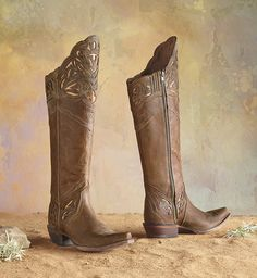 Chaparral Boots - A classic silhouette with cutaway leather overlays reveals dazzling metallic accents.