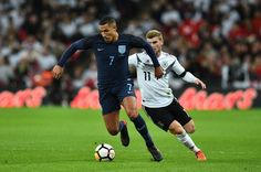 England's midfielder Jake Livermore (L) beats Germany's striker Timo Werner (R) during the friendly international football match between England and Germany at Wembley Stadium in London on November 10, 2017. / AFP PHOTO / Glyn KIRK / NOT FOR MARKETING OR ADVERTISING USE / RESTRICTED TO EDITORIAL USE