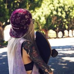 Skateboarding girl with an epic oufit.