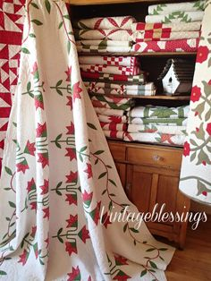 A beautiful civil war era quilt on display with gorgeous 19th century turkey red quilts. All available at www.vintageblessings.com