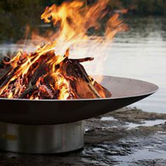 Round Raised Fire Pit by Thos. Brothers.
