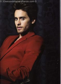 The only man I know that can pull off a red suit!