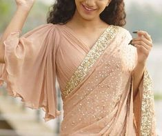Latest Bell Sleeves Saree Blouse Designs Bell sleeves have come back in trend again. And this is not just seen in the Western clothing but even for the saree blouse designs. In the recent times, you might have seen bell sleeves saree blou… Saree Jacket Designs, Fancy Blouse Designs, Latest Saree Blouse Designs, Choli Blouse Design, Blouse Styles, Designer Saree Blouses, Designer Blouse Patterns, Brocade Blouses, Saree Blouse Patterns