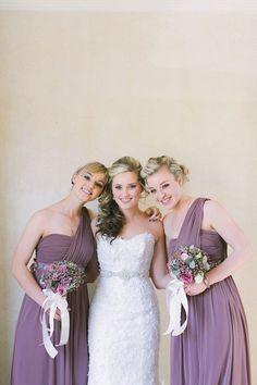 Purple bridesmaid dresses.