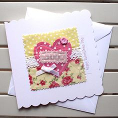 Give your loved one a very special handmade Valentines card. This pretty card has been made, by cutting floral and spot fabrics and vintage lace and creating a fabric collage using the technique of free motion machine embroidery. The card is personalised by hand stamping the recipients