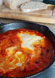 Eggs in Purgatory - egg poached in a hellishly fiery tomato sauce. The perfect way to kick off your day. #eggsinpurgatory #breakfast #eggs #tomatosauce #chorizo #recipes #breakfastideas