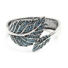 Laurel Bracelet https://patricerenee.kitsylane.com/index.php?file=pick_detail&pId=4170 ows of shimmering aqua CZ's come together, forming the veins of Laurel's adjoined leaves.  A contrast in shine and antiqued silver, this unusual piece is a stunning combination of vintage and modern glam.  - Silver tone metal, CZ's - Hinge closure