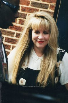 Stevie ~ ☆♥❤♥☆ ~ looking so cute in her white buttoned up blouse and floral top as she leaves the Late Show in 1998