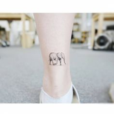 Elephant tattoo on the achilles heel.