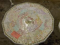 mosaic table made with hand cut tiles from vintage plates