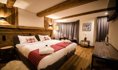 Montfort Lodge - luxury ski chalet in St Anton exclusively run by Kaluma Ski. 13 bedroom, centrally located chalet, sleeps up to Group ski holidays. Bedroom With Ensuite, Double Bedroom, Luxury Ski Holidays, Stone Interior, Jacuzzi Outdoor, Open Fireplace, Ski Chalet, Massage Room, Comfortable Sofa