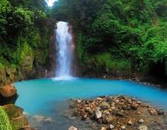 "Rio Celeste waterfall in Costa rica with a natural blue hue, one of the ""7 wonders of costa rica""...this is on my road trip around Costa rica list"