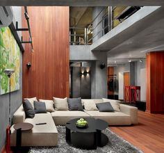 Nice use of wood and concrete to create a very interesting living space.