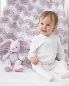 Easy crocheted waves in creamy pastels. Shown in Bernat Baby Coordinates.