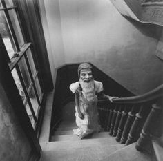 Creepy child with mask on stair #photography