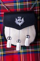 A decorative leather and fur sporran can be worn with a dress kilt.