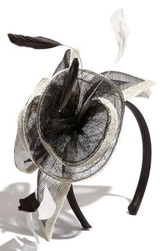 Free shipping and returns on Glint Fascinator Headband at Nordstrom.com. A flamboyant sinamay bloom is accented with airy feathers on a chic fascinator headband.