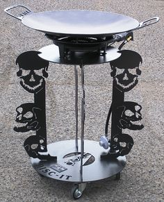 Another specific customer design request.. 3 different Skulls included in this DISC-IT Design. What design will you have us build for you? The DISC-IT Grill, also affectionately referred to as a discada, disco or cowboy wok is used to cook virtually anything you can imagine.  The DISC-IT Grill is a PATENTED product manufactured in Albuquerque, NM.  Visit us at www.disc-it.com