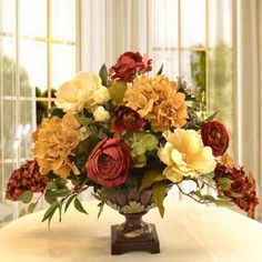"""Elegant Silk Flower Arrangement with Hydrangeas, Magnolias and Roses AR334. This silk arrangement will add elegance to any room. Created with high quality magnolias, hydrangeas, and roses. Accented with ivy in a lovely pedestal vase. Measures 22"""" H x 28 """" W"""