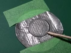 How to scratch build manhole or sewer cover For this example we are making the cover for scale. The materials needed are wire mesh, a thick metal foil such as that from a tea candle, and a coin that is similar in diameter to the cover we wish to mak