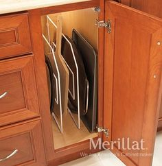 Base Wire Tray Dividers from Merillat cabinetry. A big help for small spaces. Keeps cookie sheets, cooling racks, pot lids, serving trays, cutting boards and pizza pans organized and close at hand. Pan Organization, Kitchen Cabinet Organization, Kitchen Organizers, Kitchen Storage, Organization Ideas, Galley Kitchen Design, Kitchen Cabinet Design, Kitchen Designs, Bath Cabinets